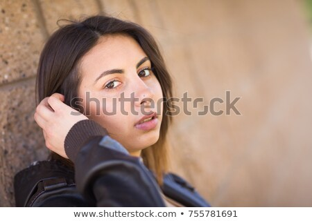 Beautiful Meloncholy Mixed Race Young Woman Portrait Outside. Stock photo © feverpitch