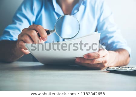 Stock fotó: üzleti · stratégia · nagyító · régi · papír · sötét · piros · függőleges