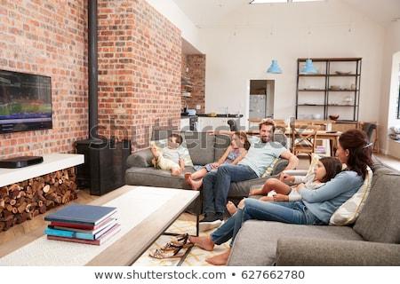 Férfi nappali tv nézés technológia portré mosolyog Stock fotó © monkey_business