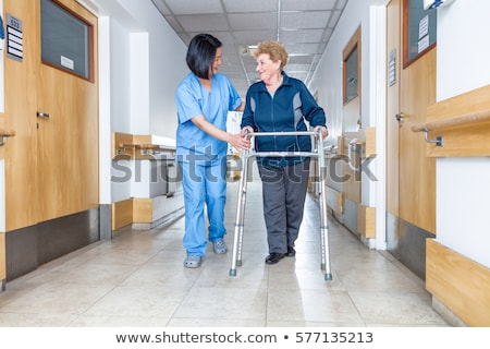 Senior woman with walker walking outdoors Stock photo © manaemedia
