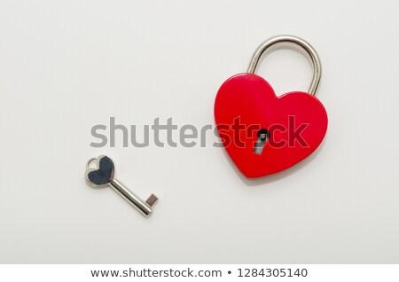 key love is to open heart shaped lock valentines day heart symbol love stock photo © orensila