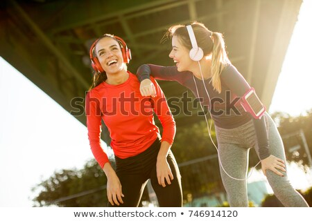 beautiful women relaxing after a long run in the city stock photo © boggy