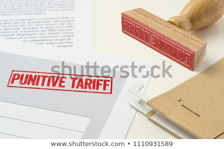 A red stamp on a document - Punitive Tariff Stock photo © Zerbor