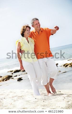 Güzel olgun çift yürüyüş plaj kadın Stok fotoğraf © hannamonika