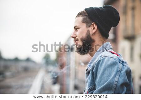 Fiatal jóképű szakállas hipszter férfi dohányzás Stock fotó © artfotodima
