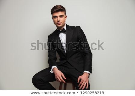 elegáns · fiatalember · csokornyakkendő · faszék · szürke · pihen - stock fotó © feedough