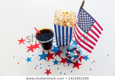 cola and popcorn with candies on independence day Stock photo © dolgachov