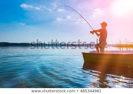Balık tutma balıkçı çubuk tekne kıyı oturma Stok fotoğraf © robuart