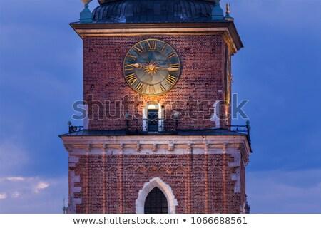 Clock on old rathaus tower in Krakow Stock photo © benkrut