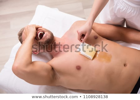 Man Screaming While Waxing Chest Stock photo © AndreyPopov