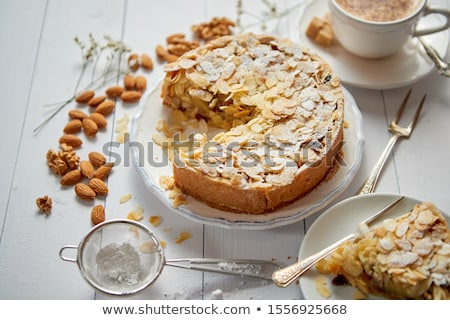 Freshly baked homemade apple pie with almond flakes cake on yellow stock photo © dash
