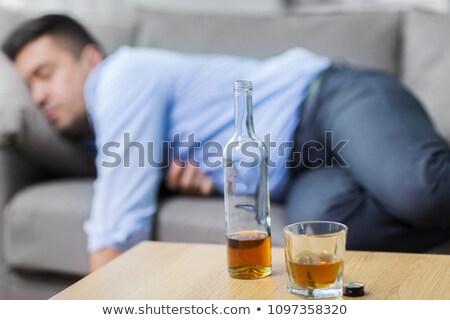 şişe alkol tablo uyku sarhoş adam Stok fotoğraf © dolgachov