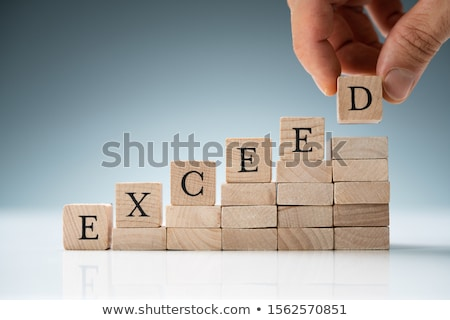 person placing stack of blocks with text stock photo © andreypopov
