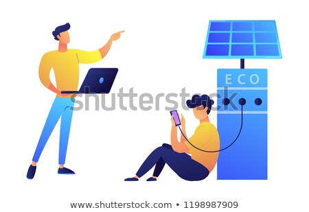 user charging smartphone from solar recarge station and programmer with laptop vector illustration stock photo © rastudio