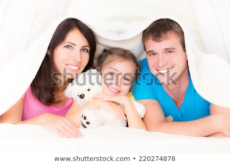 father and baby daughter with teddy bear at home Stock photo © dolgachov