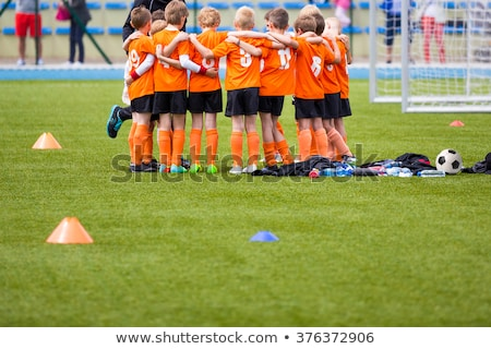 Children Sport Team Photo. Group of Young Boys Playing Soccer Stock photo © matimix