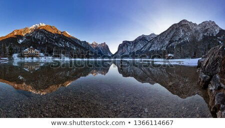 Zonsondergang wolken bergen gedekt sneeuw Italië Stockfoto © frimufilms