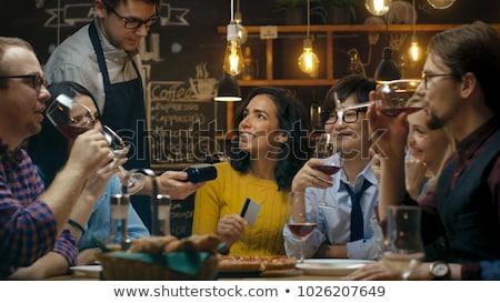 gyönyörű · fiatal · nő · fizet · kártya · étterem · étel - stock fotó © dolgachov