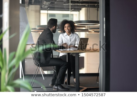 business man in office talking and smiling during corporate interview stock photo © diego_cervo