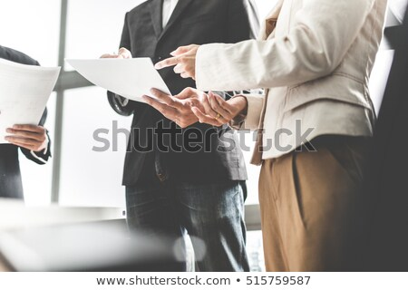pointing at business paper stock photo © pressmaster
