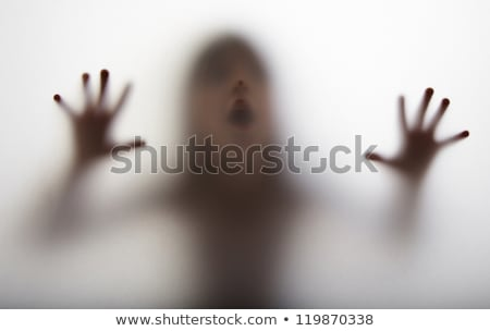 Stock photo: Scary ghost shadow behind kid