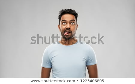 indian man making faces and showing his tongue Stock photo © dolgachov