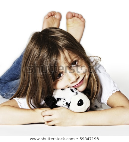 Sweet girl with puppy soft toy lying Stock photo © lichtmeister