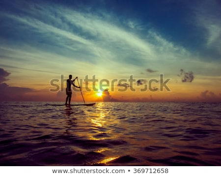 young man on a paddle board stock photo © lightpoet