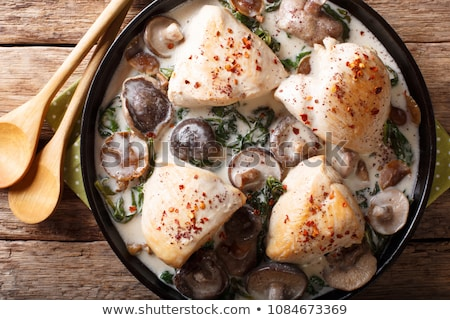 Stock photo: Stewed chicken fillet with mushrooms