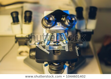 Optical microscope with four different objective lenses Stock photo © galitskaya