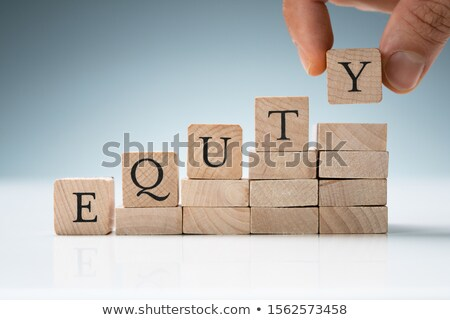 human hand arranging blocks in a row showing equity text stock photo © andreypopov