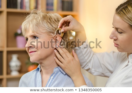 beautiful young woman with hearing aid stock photo © vladacanon