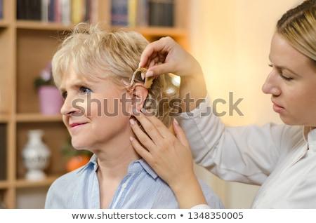 belle · jeune · femme · prothèse · auditive · coup · sourire - photo stock © vladacanon