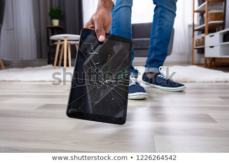 Man Picking Up The Broken Digital Tablet Stock photo © AndreyPopov