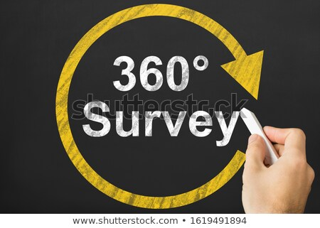Person's Hand Writing 360 Degrees Survey With On Black Board Stock photo © AndreyPopov