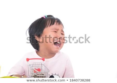 Infeliz menina carrinho de compras branco sorrir fundo Foto stock © vladacanon