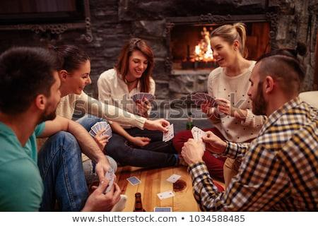 Vrienden speelkaarten drinken bier home vriendschap Stockfoto © dolgachov