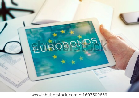 man at a desk and text eurobonds in a tablet Stock photo © nito