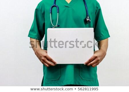 Sonriendo médico enfermera paciente Foto stock © Giulio_Fornasar