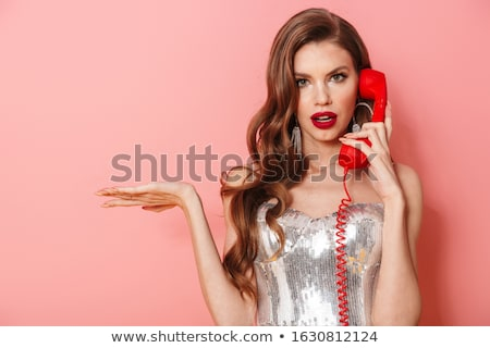 Woman in bright sequins dress isolated over pink wall Stock photo © deandrobot
