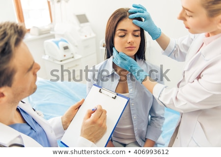 Stock photo: The woman visiting doctor for plastic surgery