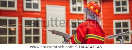 Kifejező aranyos kisgyerek játszik tűzoltó szalag Stock fotó © galitskaya