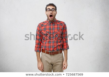 Closeup portrait of a funny geek staring at the camera Stock photo © konradbak