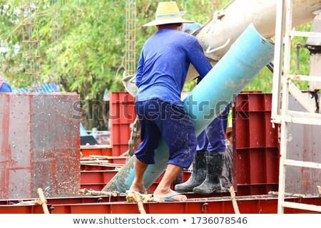 Construction workers put formwork Stock photo © deyangeorgiev
