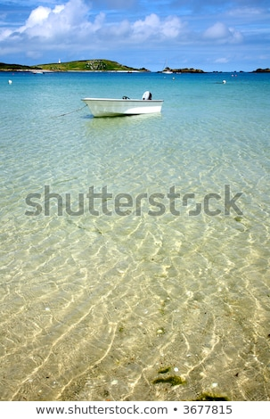 A white boat floating on clear sea, Isles of Scilly, Cornwall. Stock photo © latent