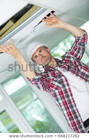 handyman hiding a cable with a plinth Stock photo © photography33