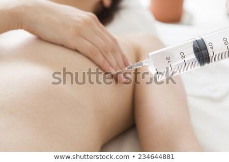 Seno olio da massaggio bella donna sottile corpo verde Foto d'archivio © CandyboxPhoto