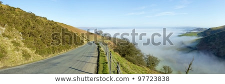 Panorama narrow road Welsh hills morning mist. Stock photo © latent