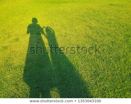 gölge · iki · kişi · çim · kadın · bahçe · boş - stok fotoğraf © wisiel