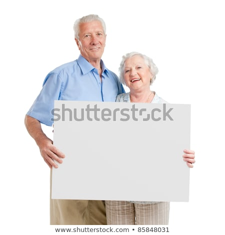 Smiling aged couple displaying blank banner Stock photo © stockyimages